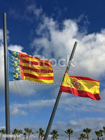 istock Valencian and spanish flags at half mast 1253843754