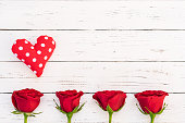 istock Valentine background with red roses and heart 895606222