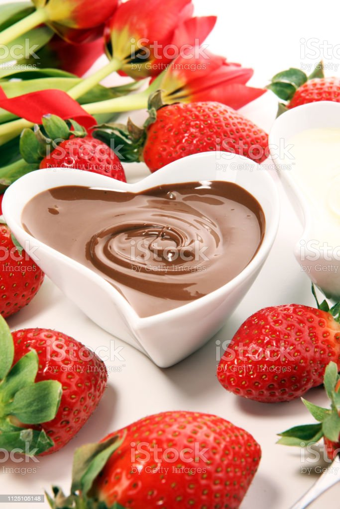 Valentine Chocolate fondue melted with fresh strawberries and dark...