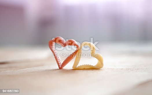 istock valentine day 2 hearts on wooden backgrounds 941682260