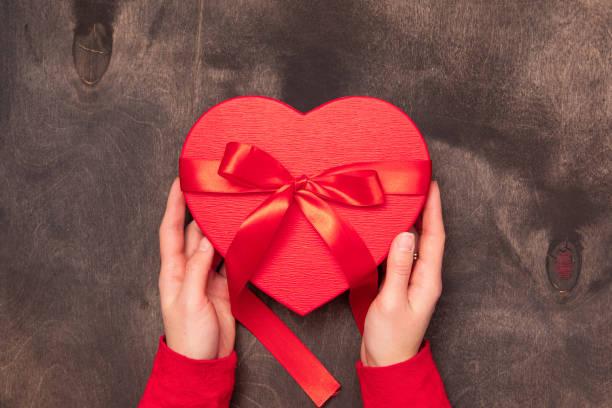 Valentine day background in beautiful style on dark wooden background picture id1197246359?b=1&k=6&m=1197246359&s=612x612&w=0&h=bawtxhukqqbgu7ncrklpulnxjte6ev9n2ontejsqevm=