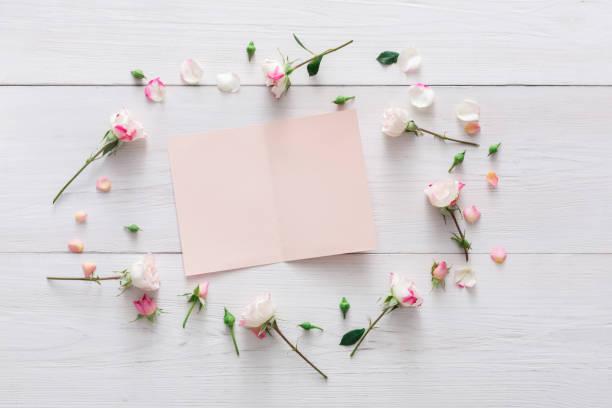 Valentine day background paper card and flowers on white wood picture id639463914?b=1&k=6&m=639463914&s=612x612&w=0&h= xsiujkk0c9cxzqgawt5b7hcwsffkolbixyb6vyefxm=