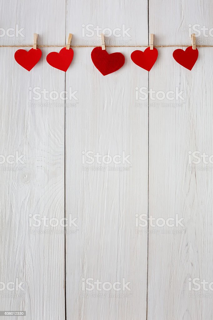 Valentine day background, paper hearts border on wood, copy space stock photo