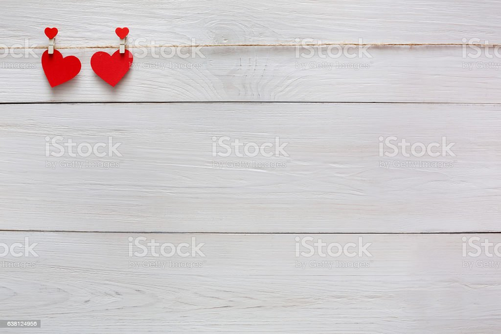 Valentine day background, paper hearts couple on wood, copy space stock photo