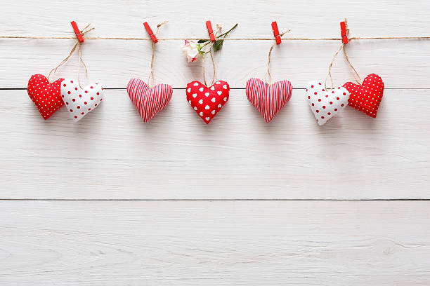 Valentine day background, pillow hearts border on wood, copy space - Photo