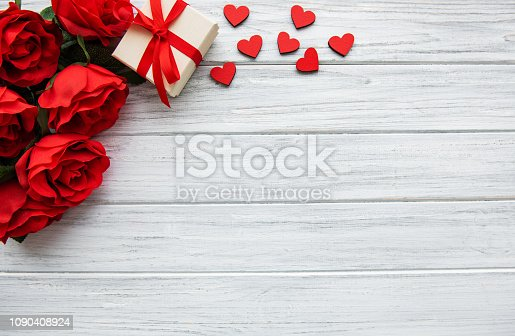 Valentines day romantic background -  red roses, gift  and  hearts