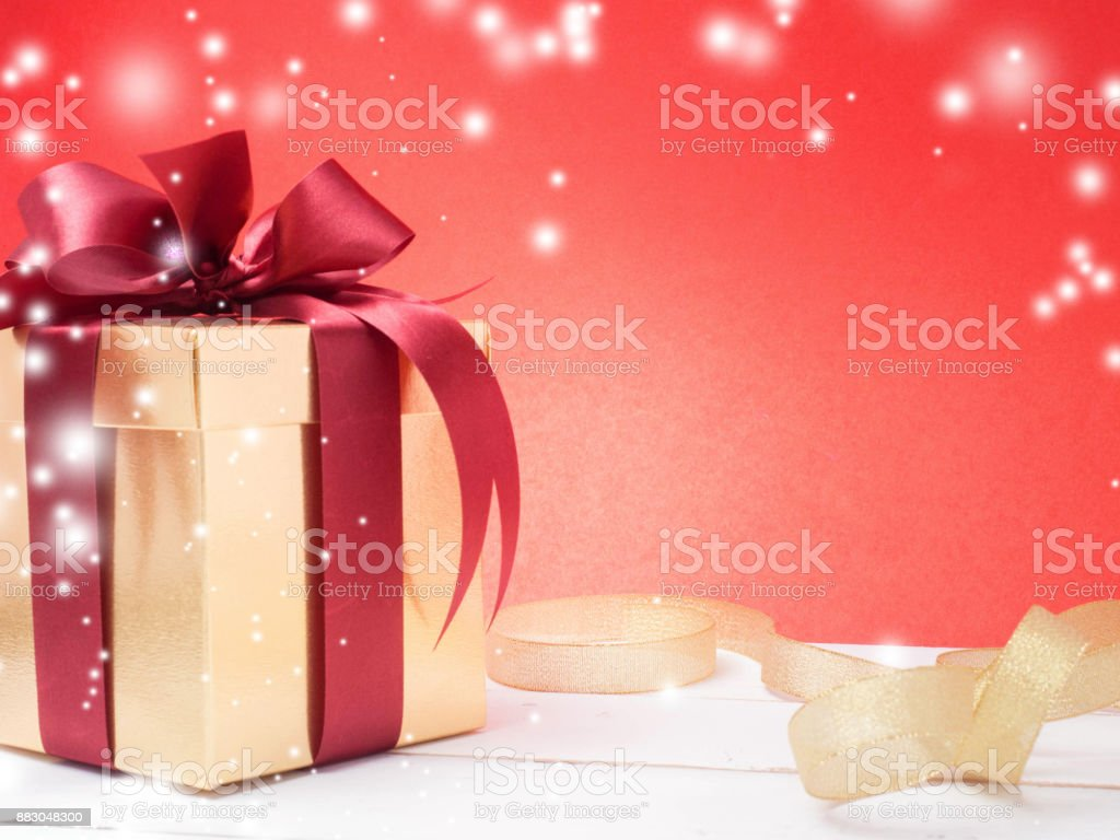 Valentine festival , New year Gold gift box with red ribbon. Red...
