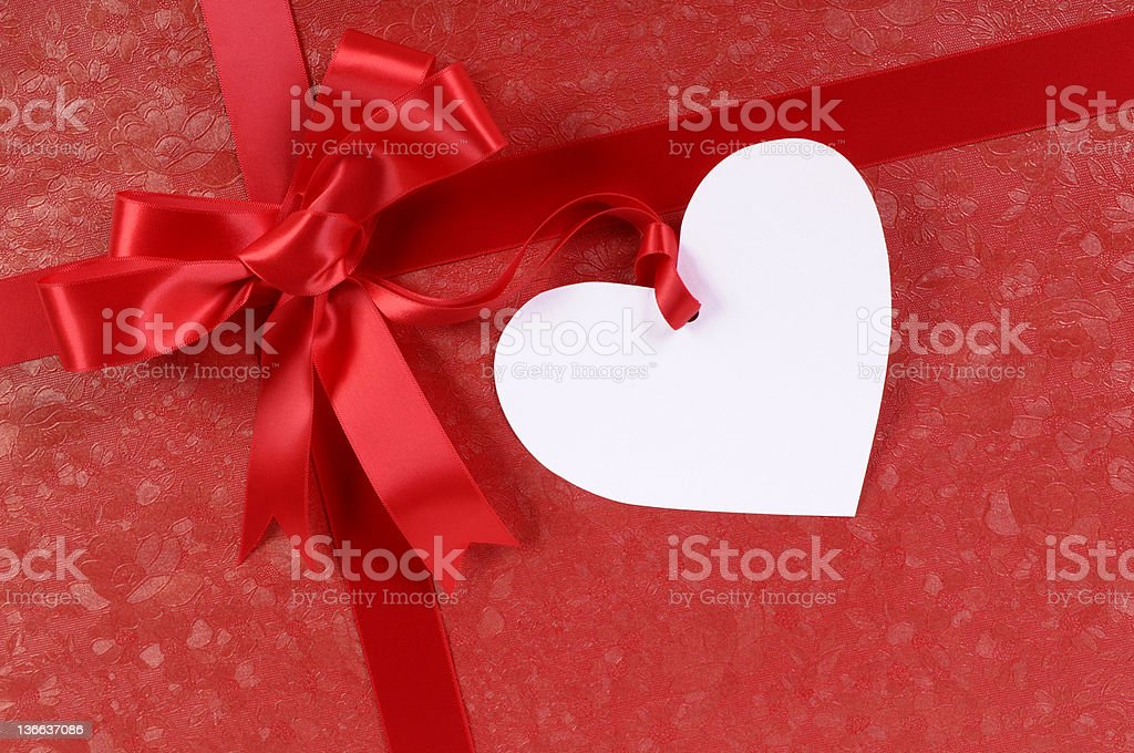 Valentine gift with heart shape tag royalty-free stock photo