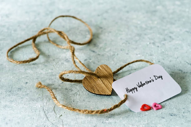 Valentine  greeting card, and wooden heart on delicate background - foto stock