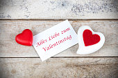 Valentine greeting card on wooden table with text