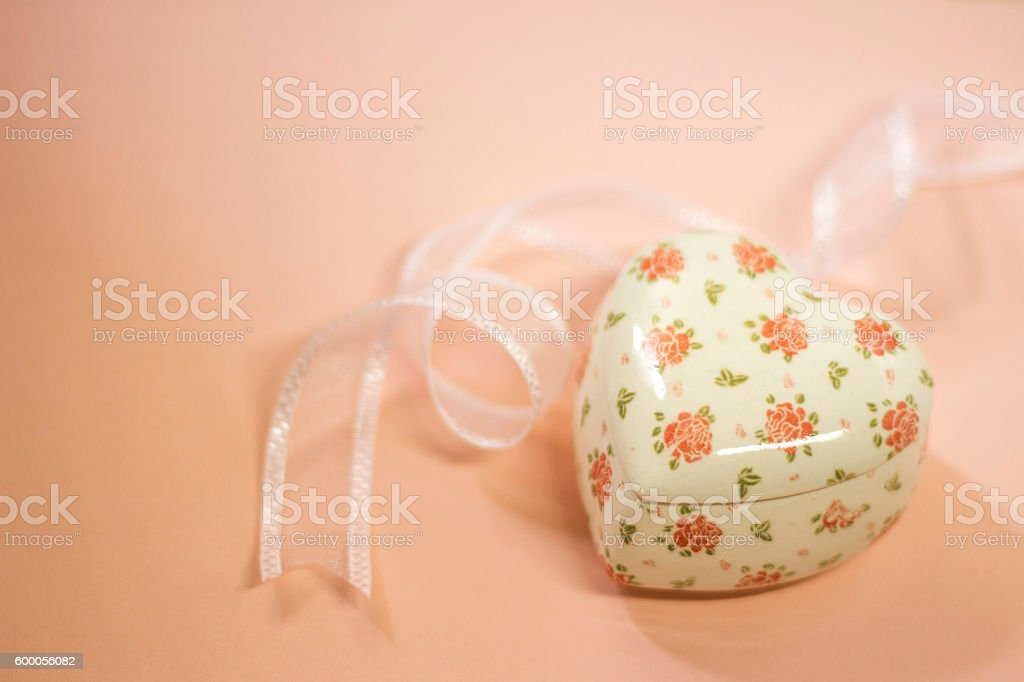 Valentine heart shaped container and ribbon stock photo