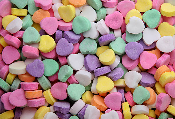valentinstag herzen hintergrund - süßigkeit stock-fotos und bilder