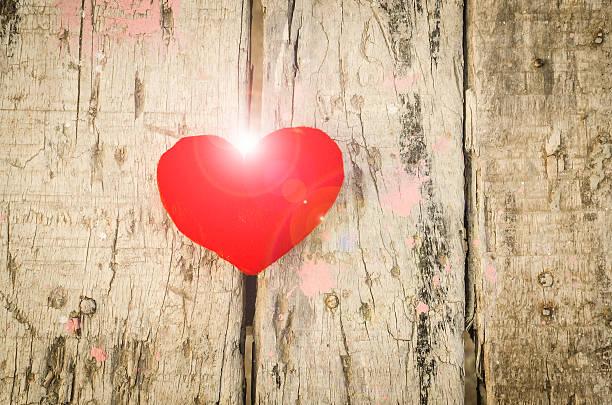 Valentine love symbol on a wooden board stock photo