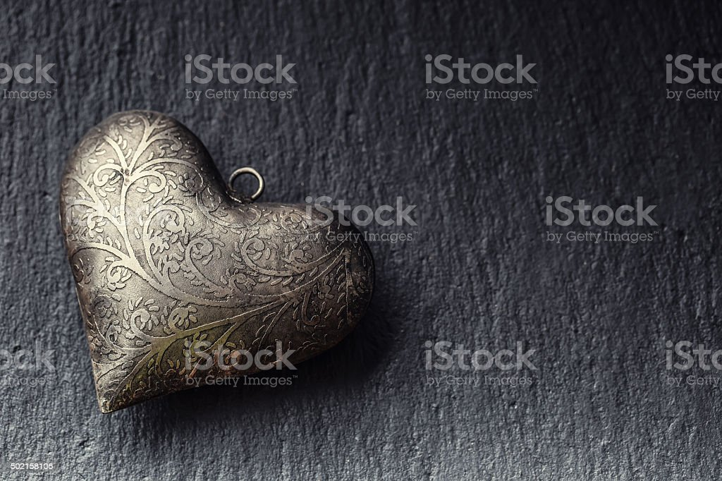 Valentine time. Valentine Metal heart on a granite board. Valentine\'s...