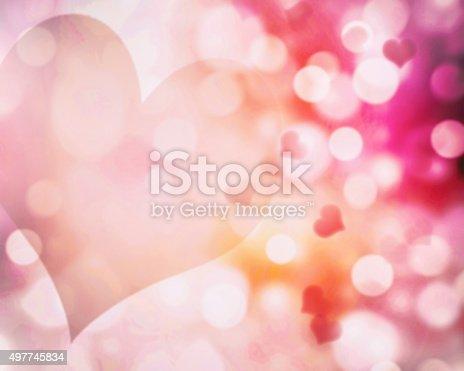 896306118istockphoto Valentine's blur pink hearts background.Abstract bokeh illustration. 497745834