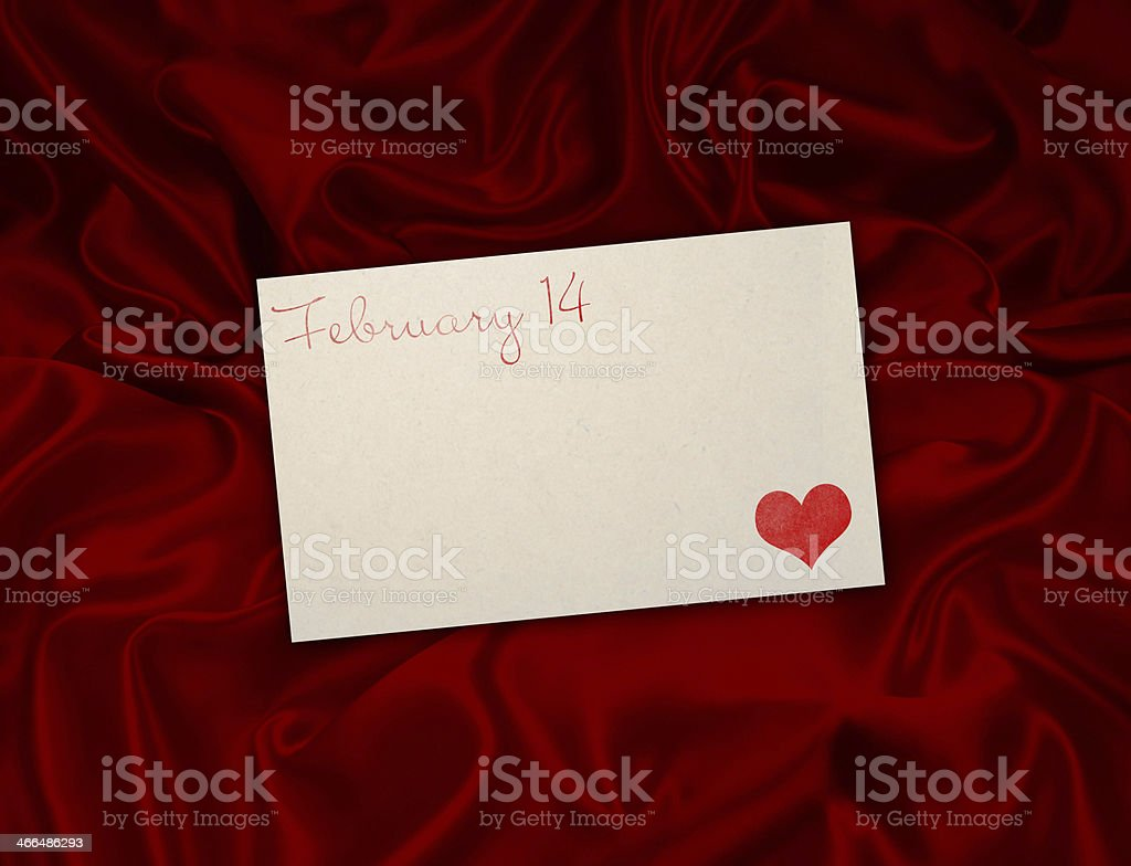 Valentine's card on silk background stock photo