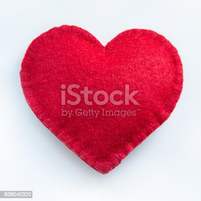 Valentine's day card. Red felt heart on white background. Top view. Isolated.