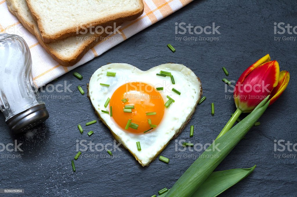 Valentine's Day abstract breakfast with egg heart stock photo