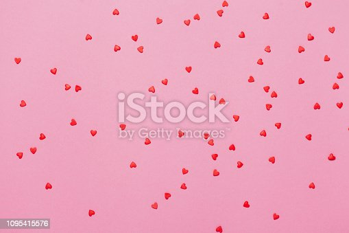 istock Valentine's day background. Little red hearts on pink background. 1095415576