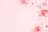 istock Valentine's Day background. Pink flowers, envelope, hearts on pastel pink background. Valentines day concept. Flat lay, top view, copy space 1200983693
