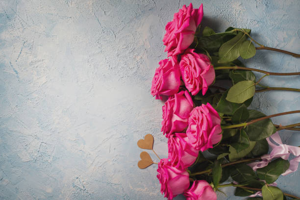 Valentines day background pink roses with two hearts over blue picture id1077189616?b=1&k=6&m=1077189616&s=612x612&w=0&h=7cn4wjc6k2dfnn1buzsyslknu0sddll2h7pgd3ab3vi=