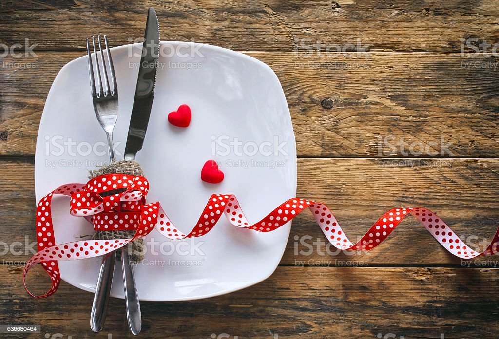 valentine's day background, white plate, fork, knife stock photo