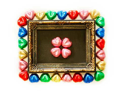 Valentines Day Background With Colorful Chocolates Heart Shape And Gold Frame From Top View Copy Space Stock Photo & More Pictures of Beauty