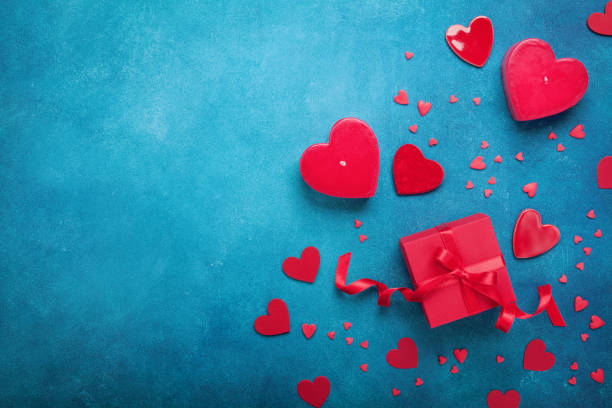 Valentines day background with gift box and red hearts. Top view. Flat lay style. stock photo