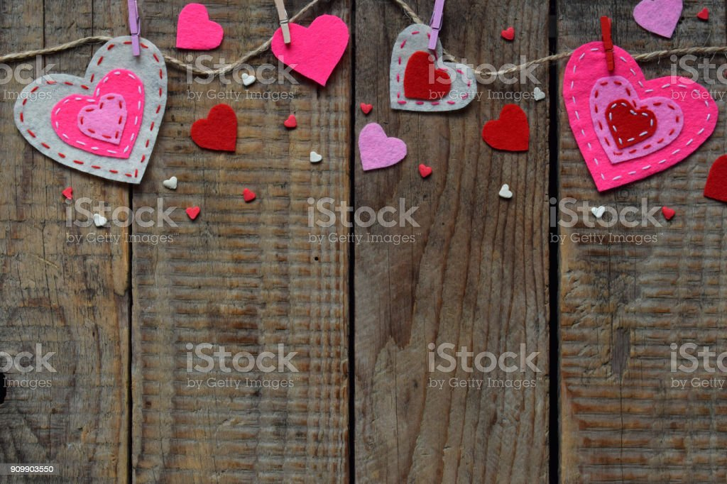 Valentines Day Background With Handmade Felt Hearts Clothespins