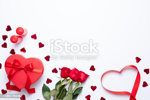 Valentine's day background with heart shape decorations, gift and ribbons. View from above. Flat lay composition