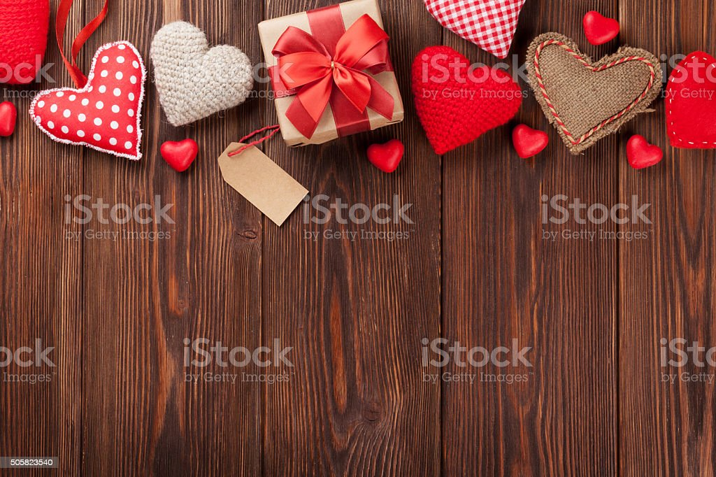 Valentines day background with handmaded hearts and candies over...