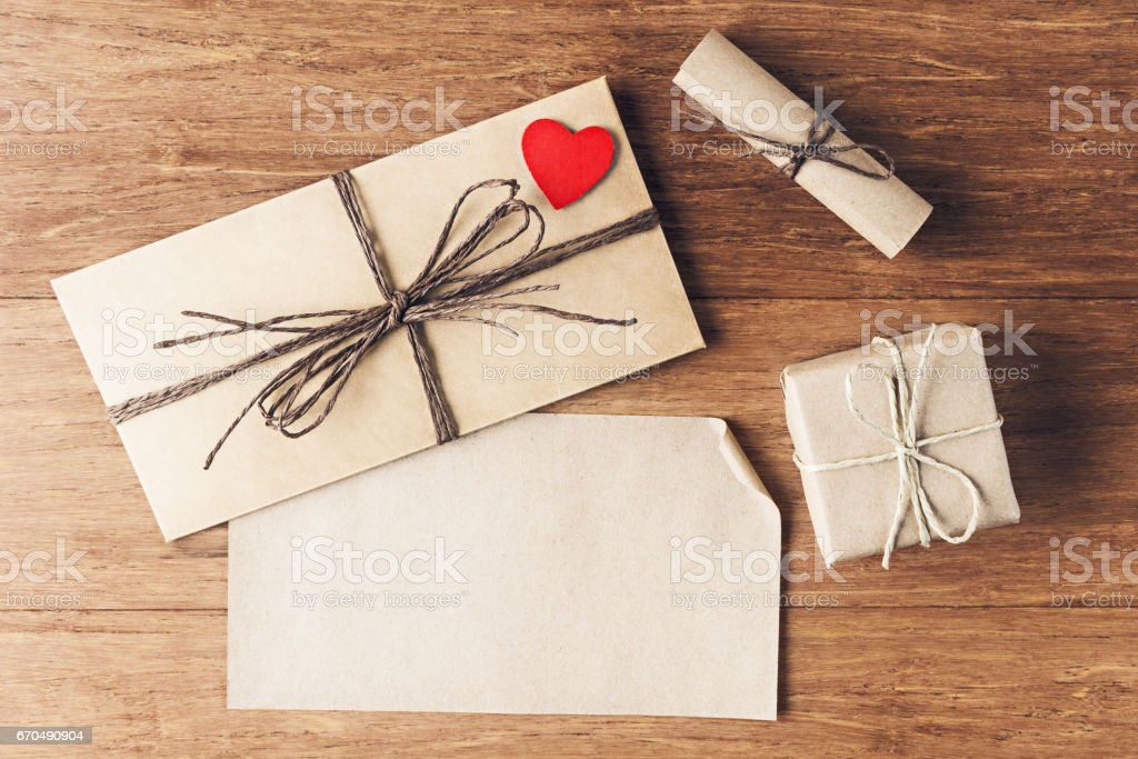 Valentines day background with love letter and small gift box stock