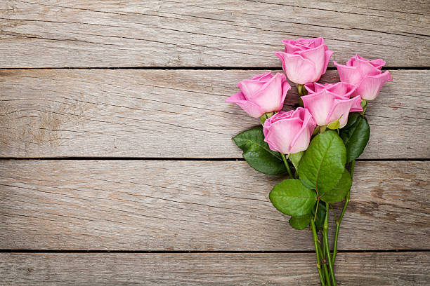 Valentines day background with pink roses over wooden table picture id535873431?b=1&k=6&m=535873431&s=612x612&w=0&h=rdcsv3zejuyfnkxn62nwxfu2kfohjelc2ftjzg0gzss=