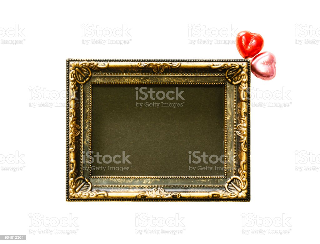 Valentines Day background with red and pink chocolates heart shape and gold frame from top view. Copy space royalty-free stock photo