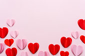 Valentine's Day background with red hearts on pink background