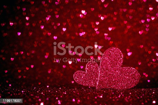 896306118istockphoto valentines day background with two pink hearts and copy space for text, be mine and love  concept 1199178001