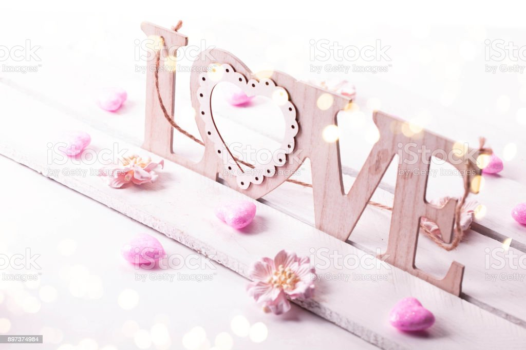 Valentines Day background with wooden word love stock photo