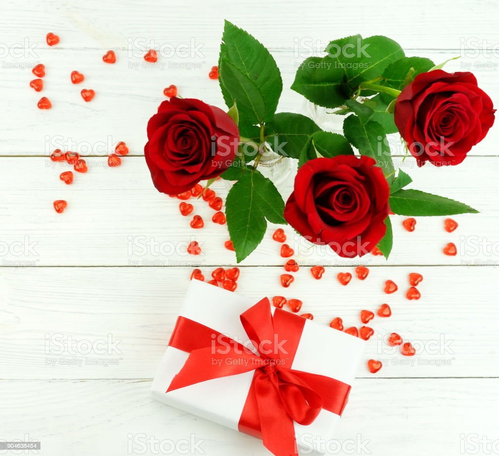 Valentines Day Beautiful Red Roses Gift And Red Hearts On White