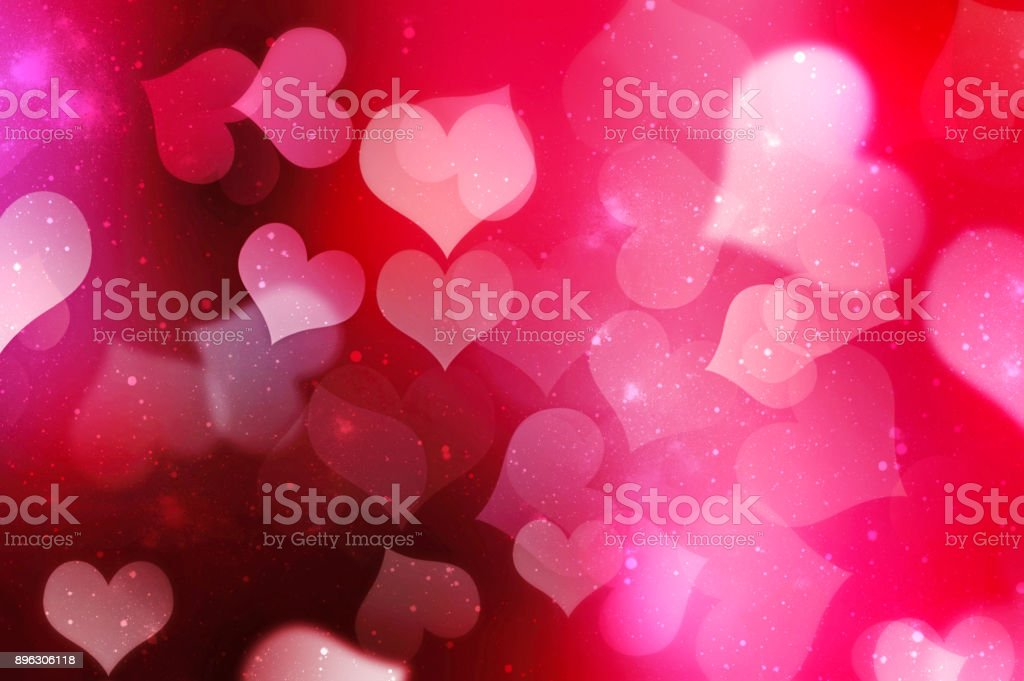 Valentines day blurred hearts background.