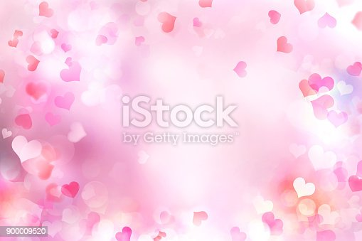 istock Valentine's day blurred hearts background. 900009520
