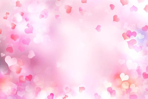 896306118 istock photo Valentine's day blurred hearts background. 900009520