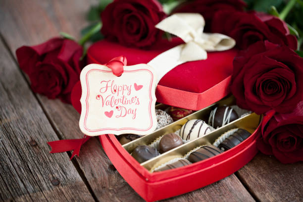 Valentine's Day Box of Chocolates and Red Roses stock photo