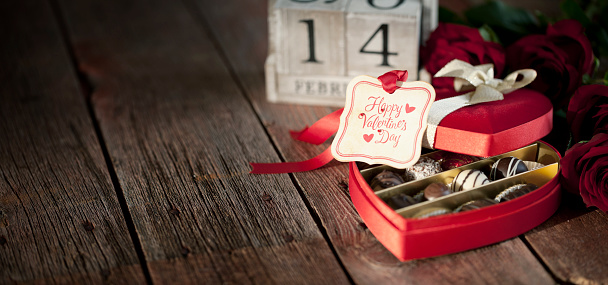 Valentine's Day Box of Chocolates and Red Roses