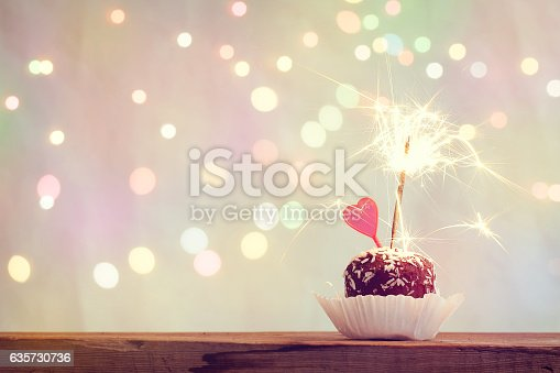 istock valentine's day cake with heart and sparkler 635730736