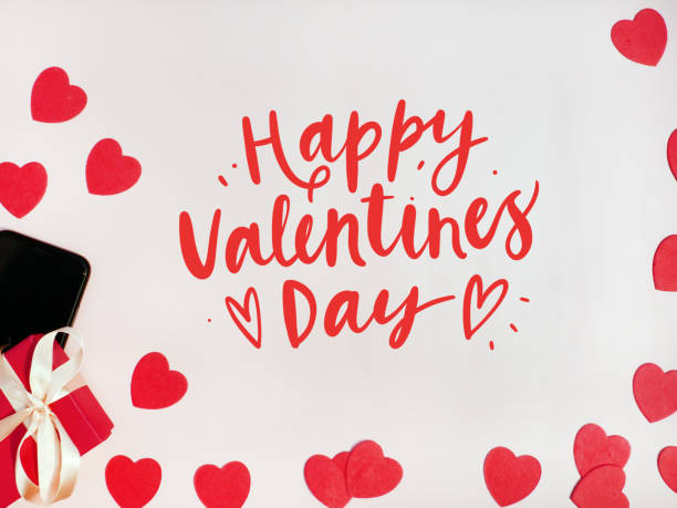 valentine's day card. composition with gifts, red hearts, mpbile phone and sign happy valentines day on white surface - contributor stock pictures, royalty-free photos & images
