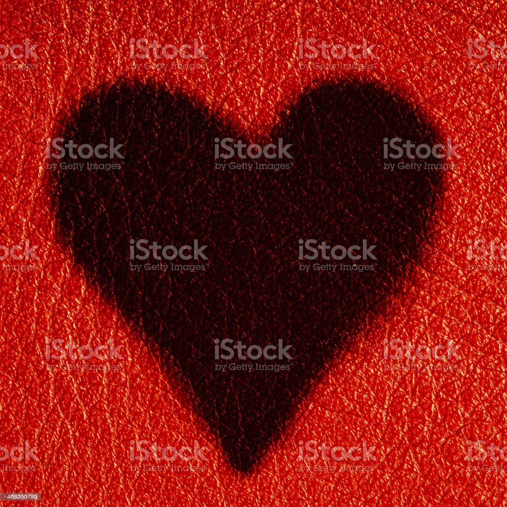 Valentine's day card. Heart love symbol on red leather background royalty-free stock photo