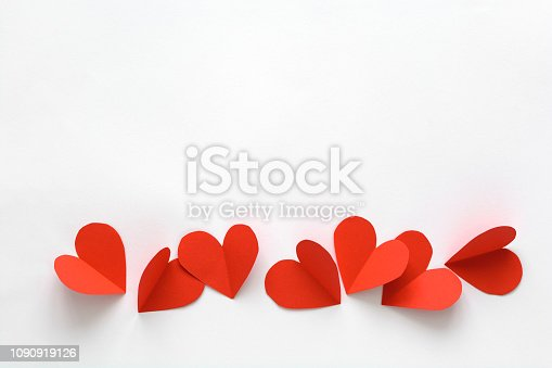 Valentines day card. Red paper hearts on white paper background. Paper cut style and minimalist concept