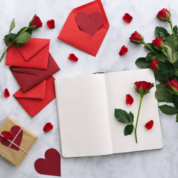 Valentine's Day cards with roses on a marble background stock photo