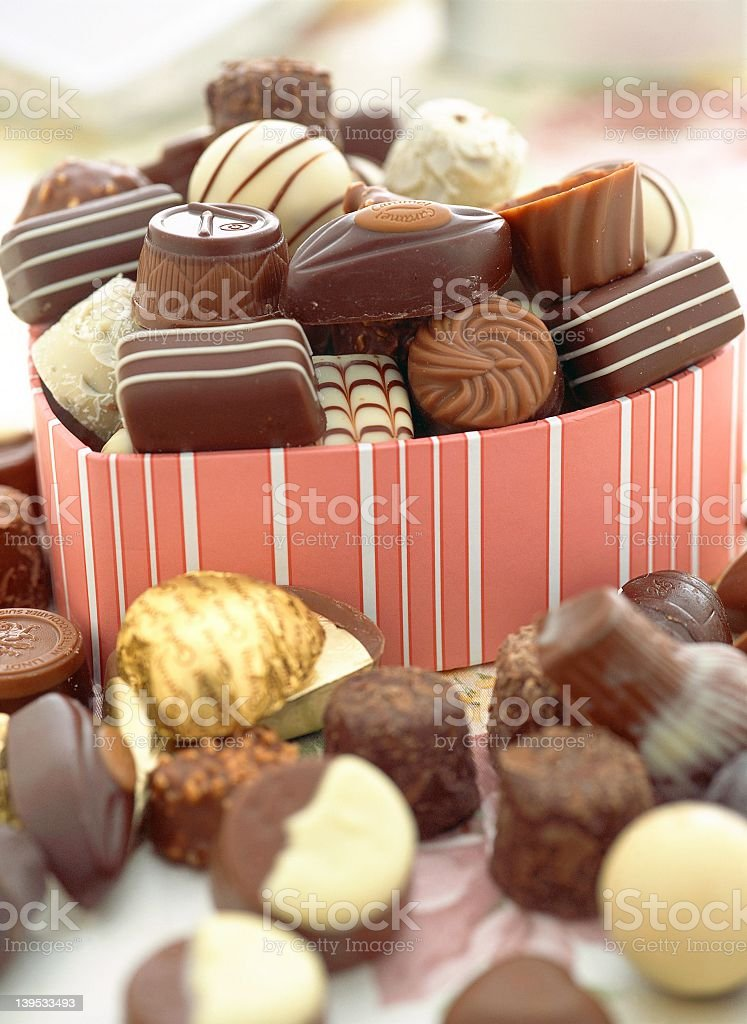 Valentine's Day chocolates overflowing from pink heart box royalty-free stock photo