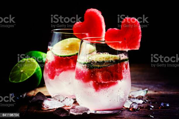 Photo of Valentine's Day cocktail with red fruit hearts=